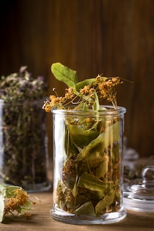 Dry linden flowers in a glass jar