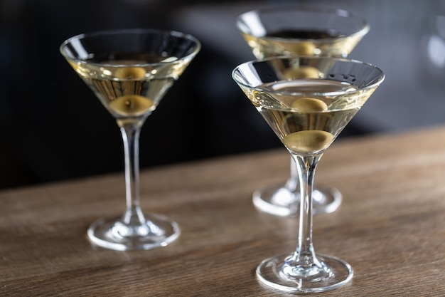 Dry martini short drink cocktail with gin, dry vermouth and an olive garnish.
