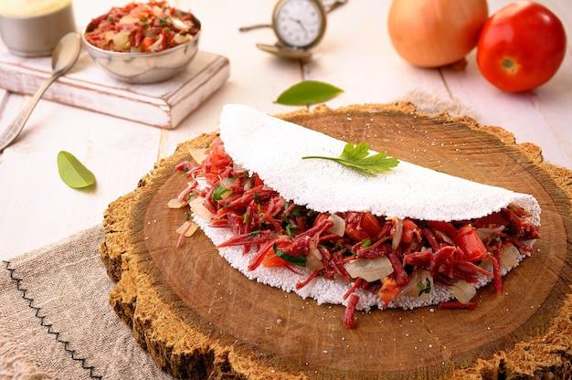Dry meat tapioca (carne seca) | - typical northeastern brazilian food