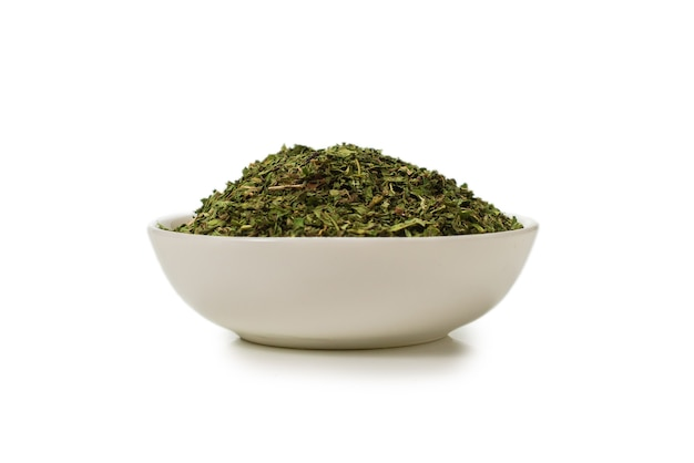Dry mint in a bowl isolated on white