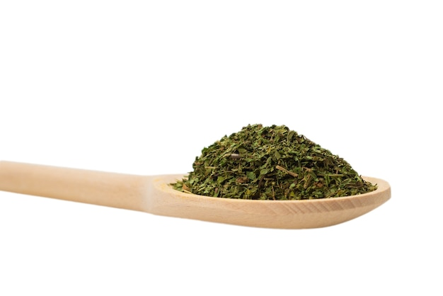 Dry mint in wooden spoon isolated on white