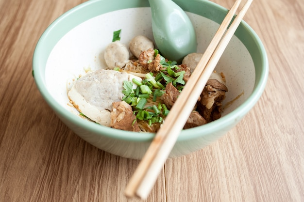 Dry noodle with pork meatball and tofu with pork