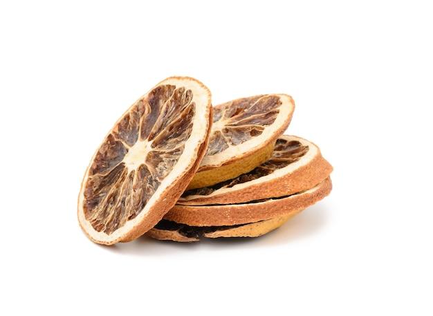 Dry orange slice isolated on white background, close up
