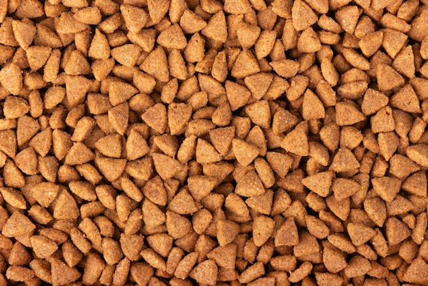 Dry pet food background. pile of granulated animal feeds