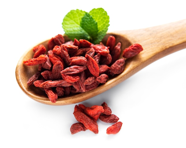 Dry red goji berries for a healthy diet on a white background
