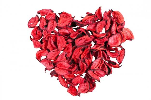 Dry red rose petals in heart shape