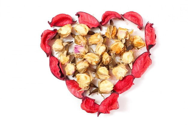 Dry red rose petals and rose buds