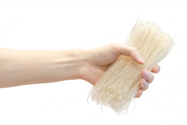 Dry rice japanese noodle in men's hand isolated on white