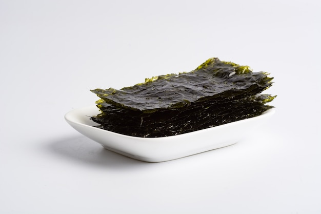 Dry seaweed on white background