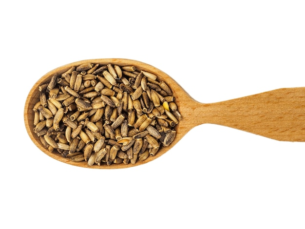 Dry silybum seeds in a wooden spoon isolated on a white background