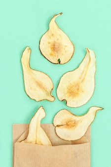 Dry slice fruits pear. tasty dehydrated fruit chips for plant-based diet.