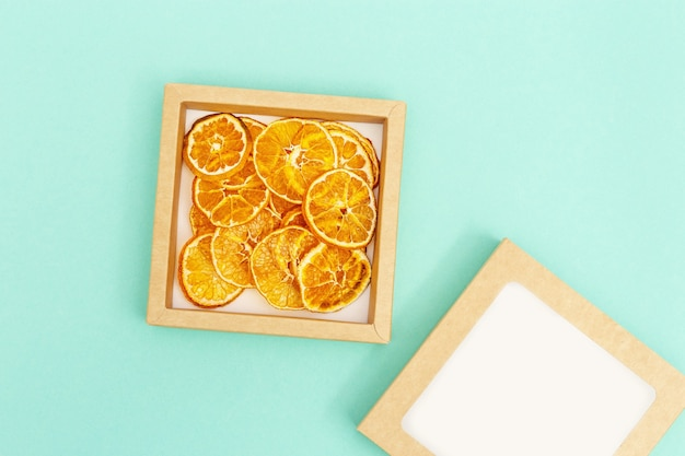 Dry slice fruits tangerine. tasty dehydrated fruit chips for plant-based diet.