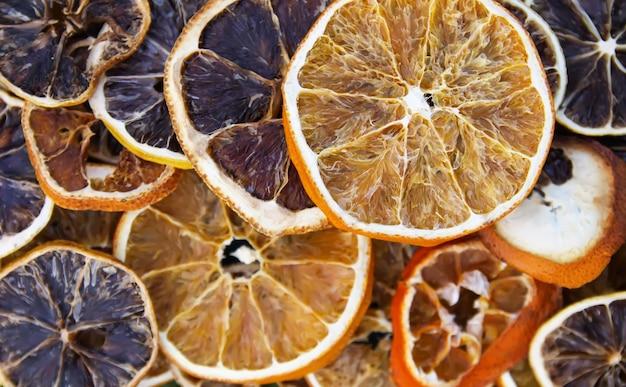 Dry slices of orange and grapefruit. fruit chips background.