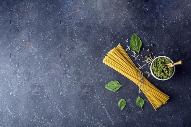 Dry spaghetti, basil leaves, parmesan