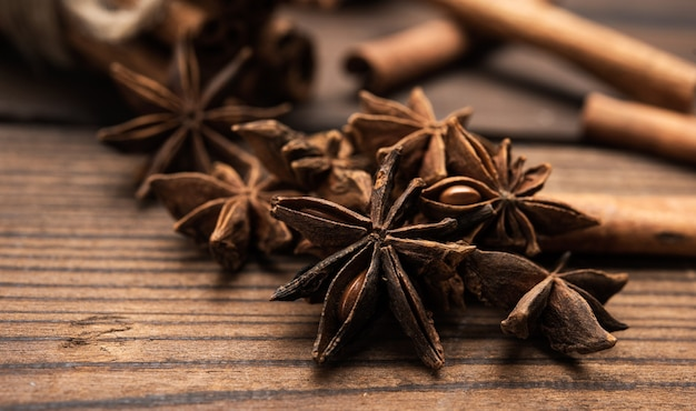 Dry star anise with a bunch of brown cinnamon sticks, close up