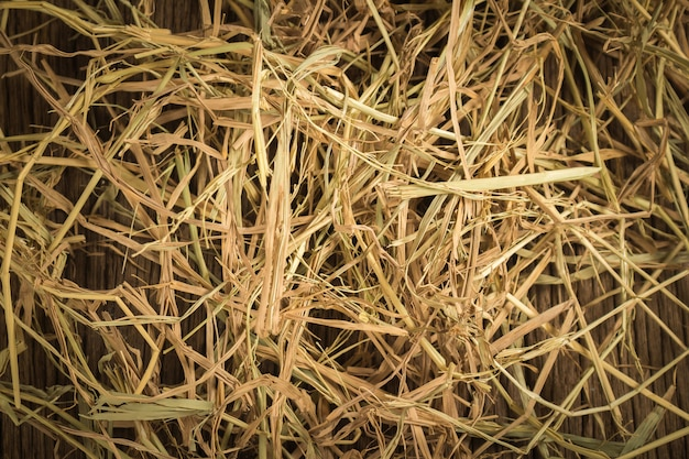 Dry straw texture background.on wood