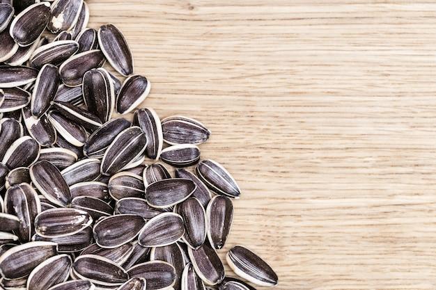 Dry sunflower seeds on wood