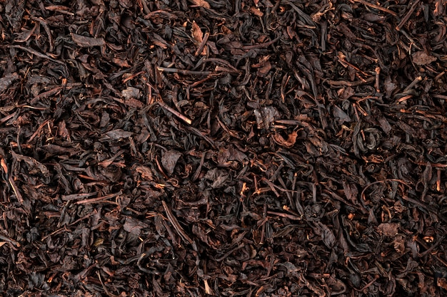 乾燥茶葉の背景やテクスチャ、紅茶パターン