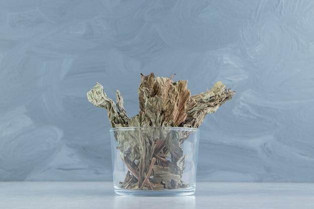 Dry tea leaves in glass