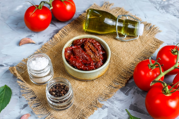 Dry tomatoes with olive oil.