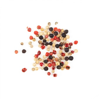 Dry trio colour peppercorn grinder isolated on white background. top view