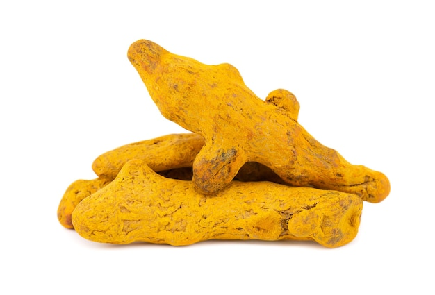 Dry turmeric root isolated on white background.