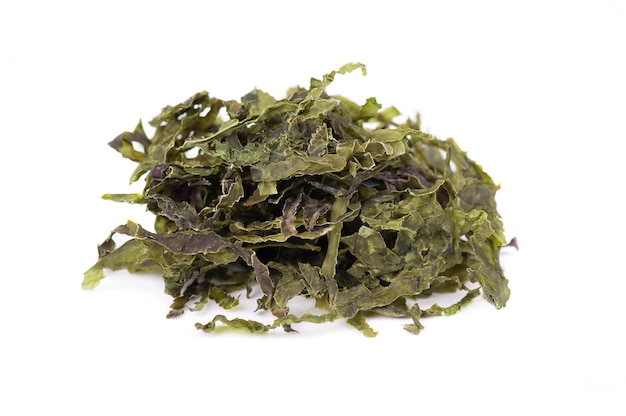 Dry wakame seaweed, isolated on white. sea kale, asian dry food.