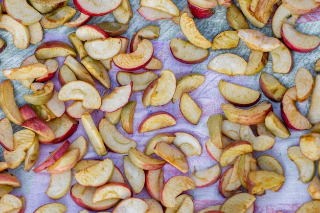 Drying apples on a flat surface, dried fruit in the sun