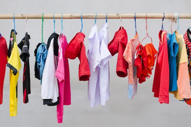 Drying clothes by using bamboo clothesline Premium Photo