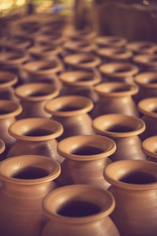 Drying handmade earthenware in rows.soft focus.vintage color