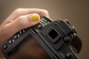 DSLR camera in womans hands