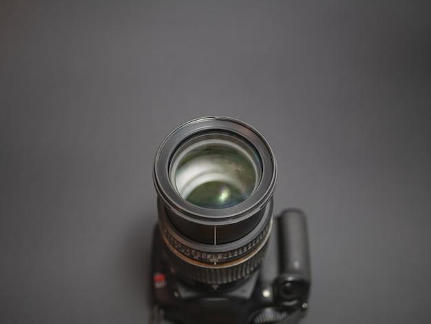 Dslr photo camera on dark