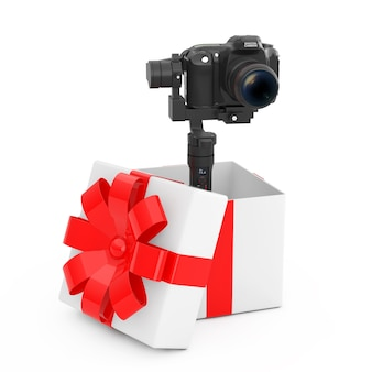 Dslr or video camera gimbal stabilization tripod system come out of the gift box with red ribbon on a white background. 3d rendering