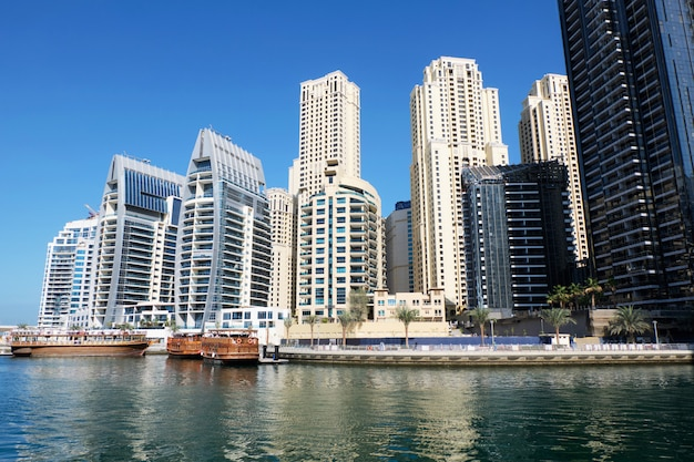Dubai cityscape with buildings and boats