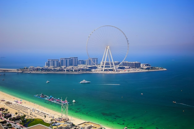 Dubai eye ferris observation wheel during sunny day, touristic attraction, luxury living