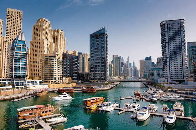 Dubai marina with boats and buildings, united arab emirates
