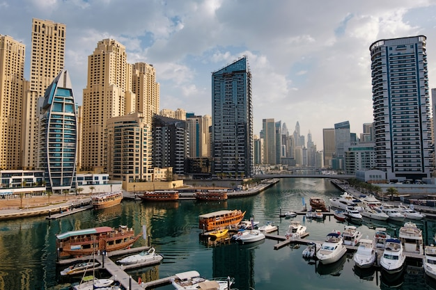 Dubai marina with boats and buildings, united arab emirates
