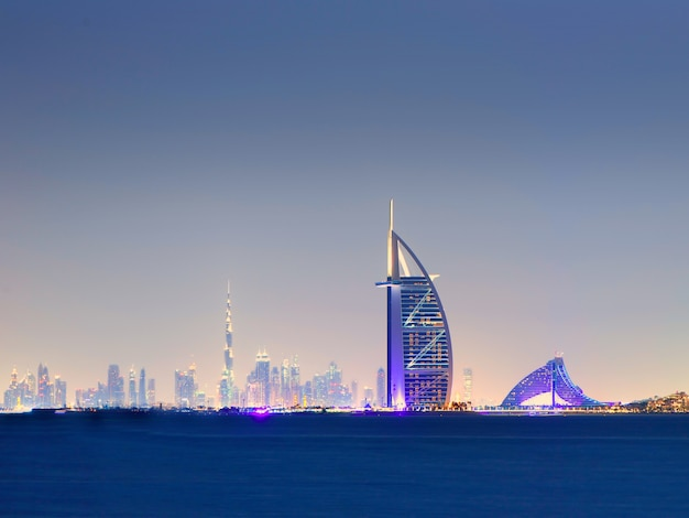 Dubai - nov 17, 2017:skyline of dubai at night with burj al arab in foreground united arab