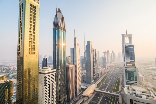 Dubai skyline and downtown skyscrapers on sunset. modern architecture concept with highrise buildings on world famous metropolis in united arab emirates