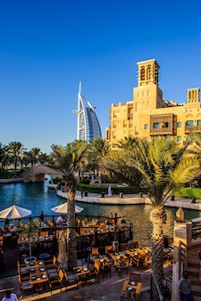 Dubai, uae - 10 october 2017: view for burj al arab hotel from the madinat jumeirah in dubai, uae. burj al arab with 321 meters high is the most luxurious 7 star hotel and a symbol of modern dubai.