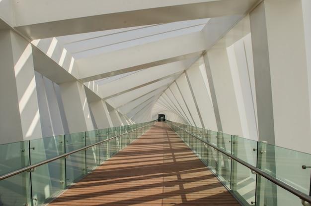 Dubai, uae - april 24, 2020: view of the modern twisted bridge crossing the dubai creek