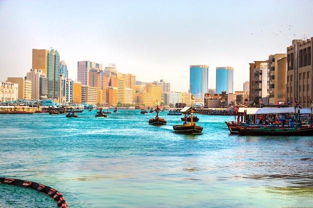 Dubai, uae - february, 2018: ancient means transportation - arab boat abra. dubai creek. retro water taxi.