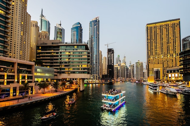 Dubai, uae - march 21: dubai marina at dusk march 21, 2016, dubai, uae. in the city of artificial channel length of 3 kilometers along the persian gulf.