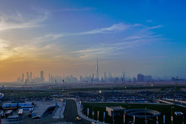 Dubai, united arab emirates, april 20, 2016: downtown dubai cityscape panoramic view from the meydan bridge at night