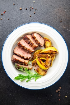 Duck breast and garnish second course side dish fresh portion ready to eat meal snack on the table