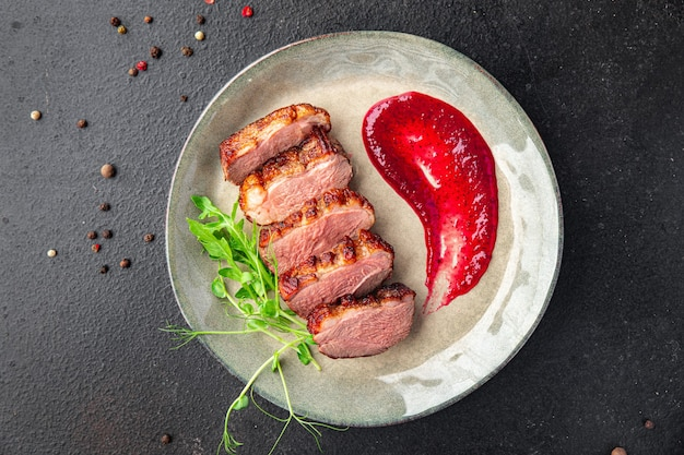 Duck breast meat and garnish poultry second course fresh meal snack on the table copy space food