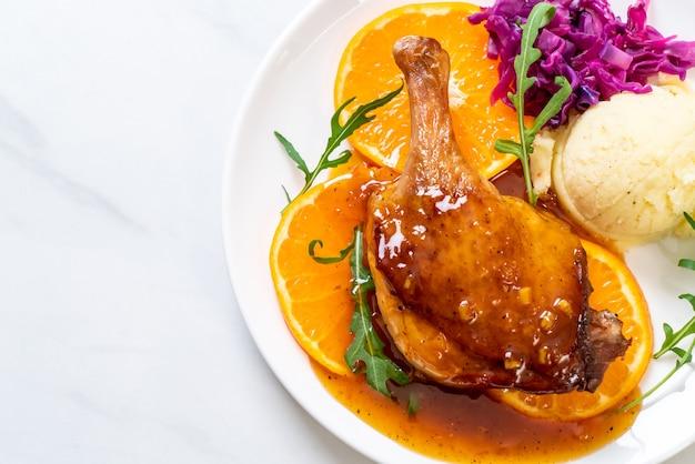 Duck leg steak with orange sauce