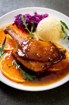 Duck leg steak with orange sauce