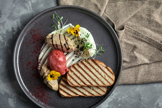 Duck paste with ice cream and grilled white bread croutons