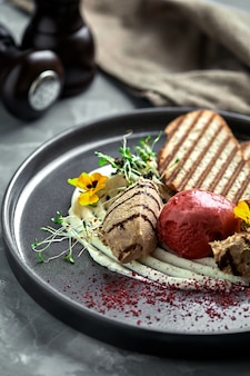 Duck paste with ice cream and grilled white bread croutons.